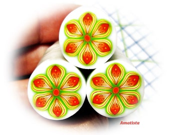 Polymer clay flower cane:  Raw clay cane - Millefiori cane supplies - Orange and green flower cane - Supplies for jewelers