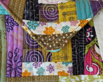 Quirky, colorful quilt as you go envelope pouch.