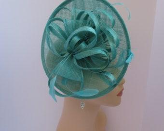 Stunning shaped Sinamay Fascinator Hat on a Headband Turquoise