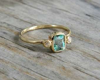 Emerald and  Moissanite Ring in Brushed 14k Yellow Gold