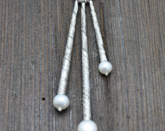 Silver pendant with natural pearls.