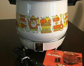 1970's Westbend, West Bend Lazy Day Slo-Cooker Kitchen Print Porcelain on Steel with Instruction Booklet.