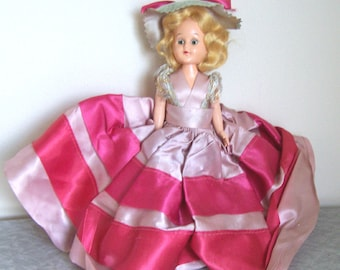 Vintage 50s doll in fancy dress - moveable plastic with open and close eyes