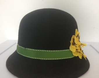 Black cloche hat with yellow pansies