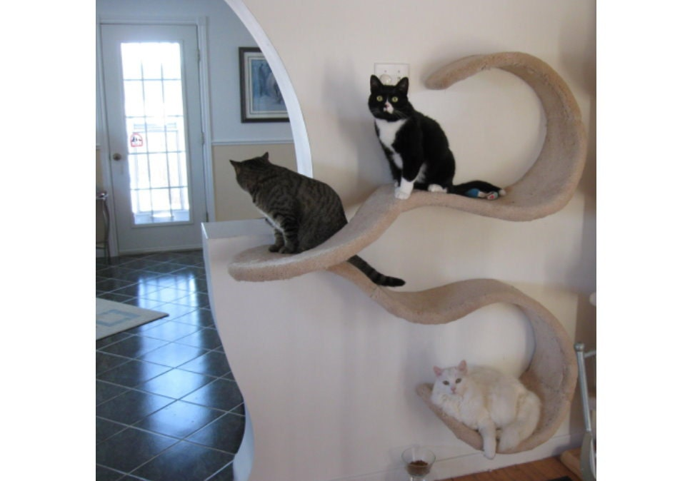 Wall mounted cat shelf the double wave for Interesting cat trees