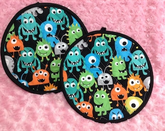 Cute Colorful Monster With Black Background Pot Holders