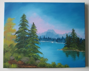 Acrylic painting of lake and trees with far off mountains sunrise sky