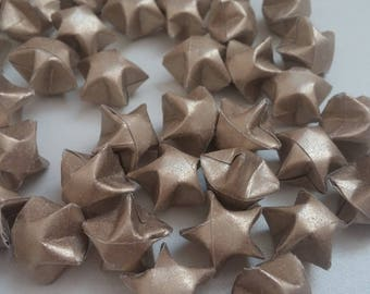 Set of Golden eyeshadow origami stars