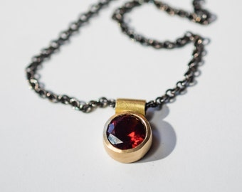 18K gold choker pendant with garnet on oxidized silver chain