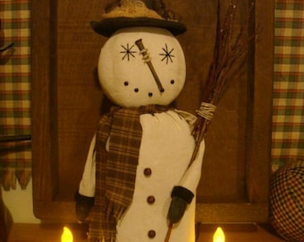 Primitive Snowman with broom