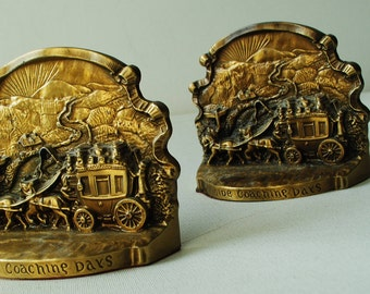 "Americana vintage 50s, bronze color brass bookends""  Ye olde coaching days"". Philadelphia heritage collection."