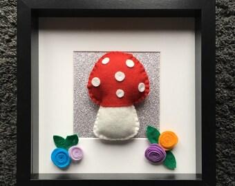 Handmade felt toadstool, mounted in a black wooden box frame.