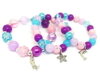 Under the sea themed party favor bracelets in organza bags with special birthday girl bracelet!
