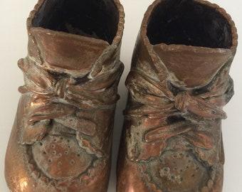 Vintage copper baby shoes