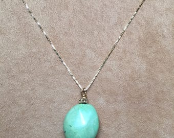 Green turquoise pendant on 14 carat gold chain