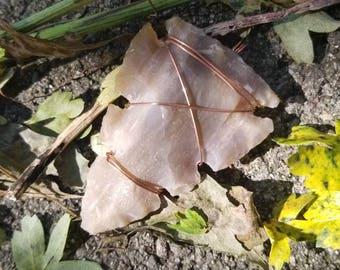 Agate arrowhead pendant wrapped in copper