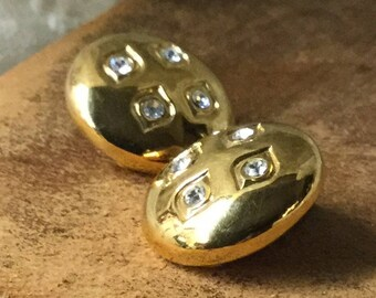 Dainty Sparkling Clear Rhinestone Gold Tone Button Earrings Unsigned Clip On 1980's 1990's Round Circular Puffed Shiny Finish Chic