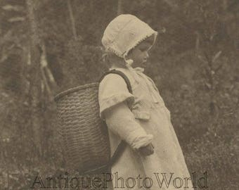 Little girl berry picker in woods with basket antique art photo