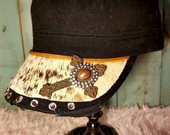 Distressed charcoal cargo cap with brown and white cowhide, rhinestones and cross