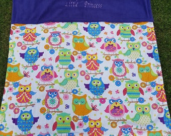 Reversible owl print baby blanket lined in fleece.