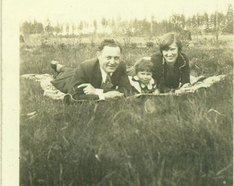 1930s Family Laying on Blanket Picnic Grass Little Girl Joe Gloria Madge 30s Antique Vintage Photograph Black White Photo