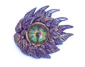 Purple dragon eye brooch