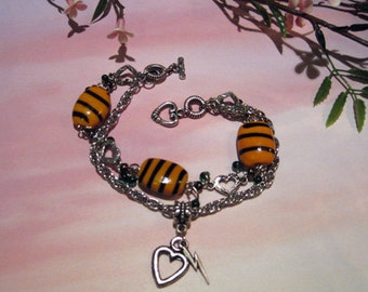 Crazy Little Thing Called Lum: a multi-strand fan charm bracelet for Urusei Yatsura in base metal and glass