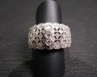 18k yellow gold ring with genuine brilliant shaped diamonds, Buccellati style, 1960