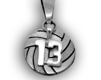 Volleyball pendant with sports number attached