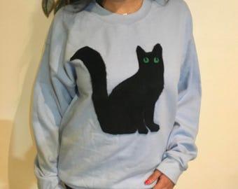 Silhouette Black Cat Plush Application on a unisex Light Blue Sweater -  MEDIUM