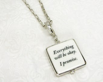 Sterling framed Photo Pendant Necklace with a personalized message.