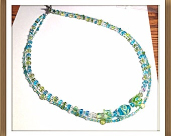 Handmade MWL blue and green lampwork necklace. 0262