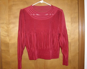 Red pleated blouse from Japan.