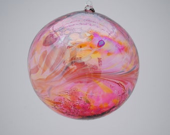 e00-64 Extra Large Iridescent Ornament Ruby with colored chips melted on top.