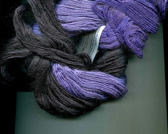 Silk Rhapsody from Art Yarns. Hand Painted Silk and Kid Mohair. Color #117 (Grey), #107 (Turquoise), #138 (Purple/Black), #248 (Brown)