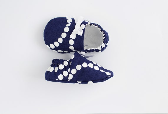 Navy and white cotton lined baby girl shoes with satin ribbon bow detail.