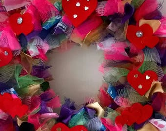 Rainbow coloured fabricwreath with red felt hearts