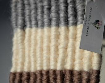 Long Woolen Macrame Wallhanging on a small iron stick