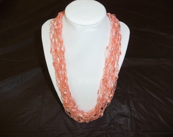 Light Coral ribbon lattice crocheted necklace.