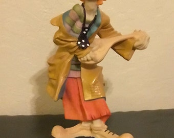 Clown Figure playing Mandolin