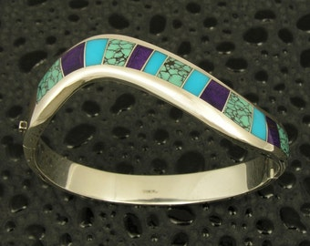 Silver hinged bracelet inlaid with spiderweb turquoise, sugilite and turquoise by Mark Hileman.