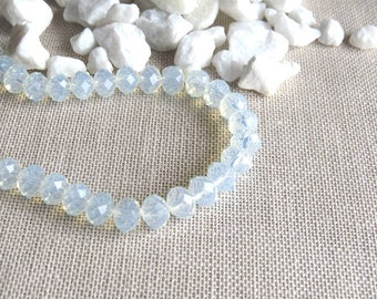 Set of 10 faceted white glass beads