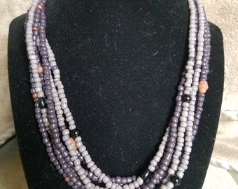Beautiful multi strand necklace with soft colored accent beads.