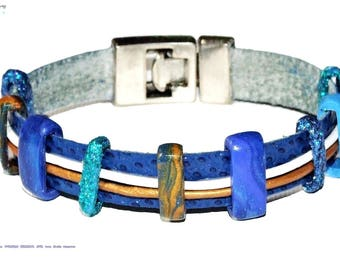 Modern bracelet in blue, white and golden leather.Donuts in fimo.