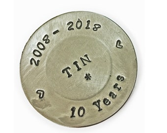 10th anniversary gift. Mini Plate stamped 2008-2018 cast in Tin.