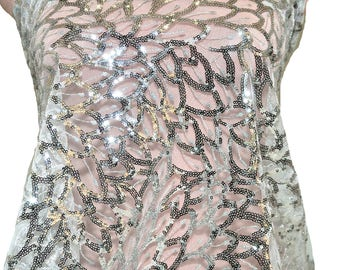 Sewn on Silver sequin fabric on mesh.. dance, pageant, theater, costume, crafts, formal wear, decor, prom