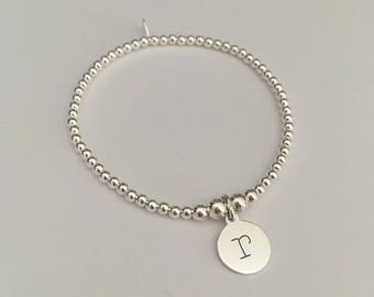 Sterling Silver stretch bracelet with 1 Lowercase Initial charm pendant