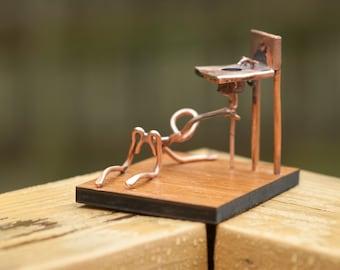 Copper Art Figurine of a plumber.