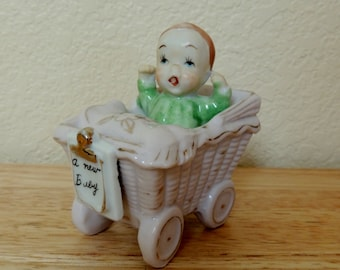 Pink Baby Figurine Baby in a Carriage