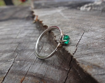 Emerald engagement ring in gold and silver